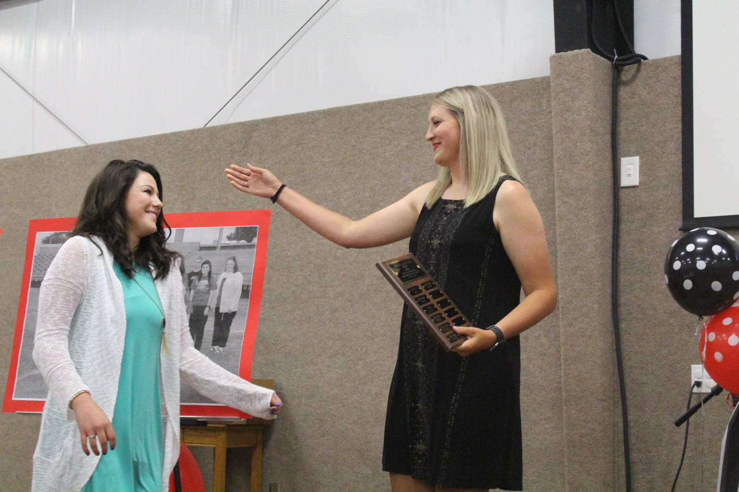 Senior+Caroline+Britten+receives+the+%22Tigerette+of+the+Year%22+award+from+Coach+Nicole+Black+on+Tuesday%2C+May+16+at+the+annual+athletic+banquet.+Britten+has+participated+in+basketball%2C+tennis%2C+track%2C+cross+country%2C+National+Honor+Society%2C+student+council%2C+Academic+UIL%2C+and+One+Act+Play+all+through+high+school.+%22She+is+a+big+role+model+to+not+only+me%2C+but+lots+of+younger+girls%2C%22+sophomore+K%27leigh+Keesee+said.