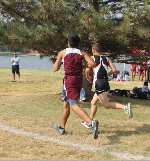 Andrew Ingle, guest columnist and varsity runner, passes a competitor on his left at a practice meet in Amarillo earlier this fall. In anticipation of the district cross country meet to be held in Groom on Monday, Oct. 21, Ingle wrote a guest column targeting those who might be interested in distance running. English II writers, like Ingle, have made significant contributions to The Times of the Tiger this year.