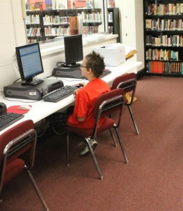 Tanis Terbush  takes an AR quiz on Monday, not letting homecoming week distract him from doing his work. Terbush headed to the library while sporting his crazy hair on pajama day. The remaining dress-up days include Tuesday's