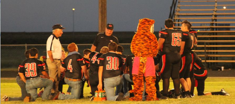 The Tigers reflect together with their coaches following a big 56-0 win over Kress on Sept. 20 at home in Tiger Stadium.