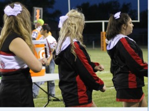 Groom high school cheerleaders engage fans in a cheer at the Higgins game on Sept. 13. Senior McKenna Britten, Senior Katelin Weller, and Junior Emily Trevino shout