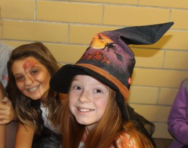 Undead student Hallie Thompson shares a moment with her witch friend, Ginna Miller.