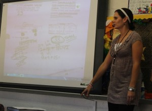 Groom's third-grade teacher, Jessica Shuck, reviews her students' work on a math lesson. Shuck taught this particular lesson on Wednesday, Oct. 2. The new teacher, a Groom graduate herself, was a member of the homecoming court in some capacity all four years of high school.