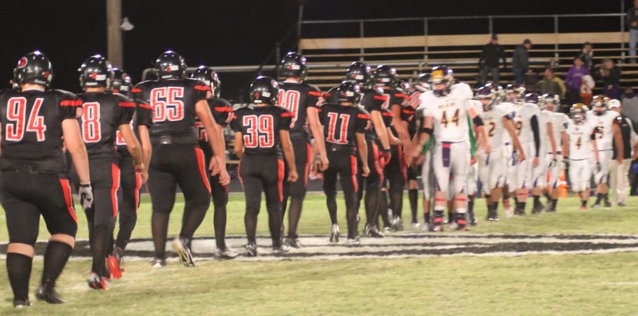 The Tigers shake hands with the Warriors following a Groom homecoming victory. The Tigers won 67-22.