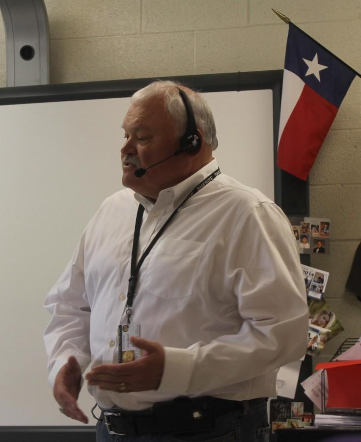 Sheriff Loren Brand speaks with the  journalism class on Oct. 13, 2014, about law enforcement lessons and purposes for writing in a variety of circumstances. In addition to being employed as the Carson County sheriff, Brand also is a published author and criminal-justice speaker.
