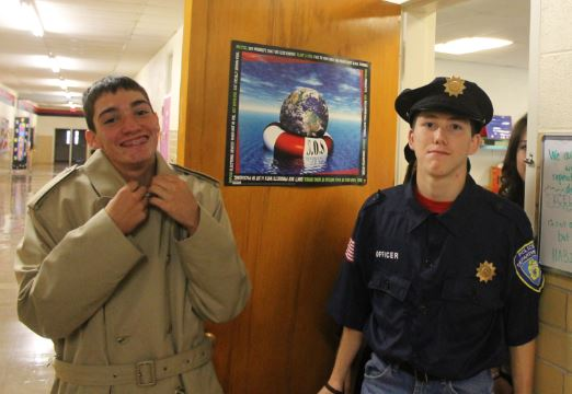 Carson Ritter and Nate Roskens get ready for the show. Ritter plays  Detective Woolrich. Roskens portrays Officer Garrett.