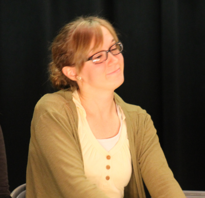 Senior Cari Weinheimer grins as she performs in the theater class's fall production. Next month, May 26, Weinheimer will compete in ready writing at state in Austin.