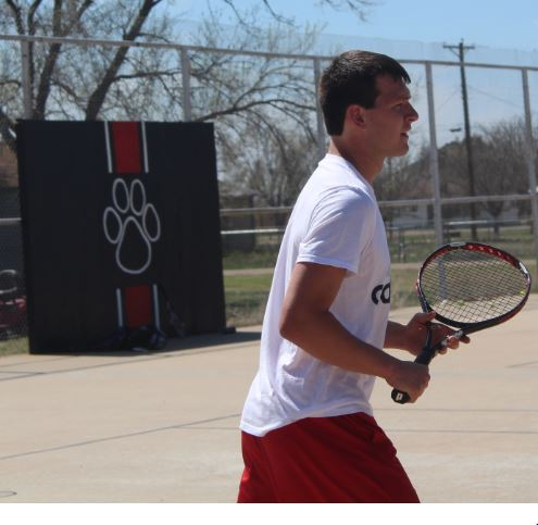 Senior Hayden Ritter gets ready to return the ball at the practice Groom tennis meet. Ritter was selected as the third week's male Spring Sport's Star. Ritter competes in both tennis and track.