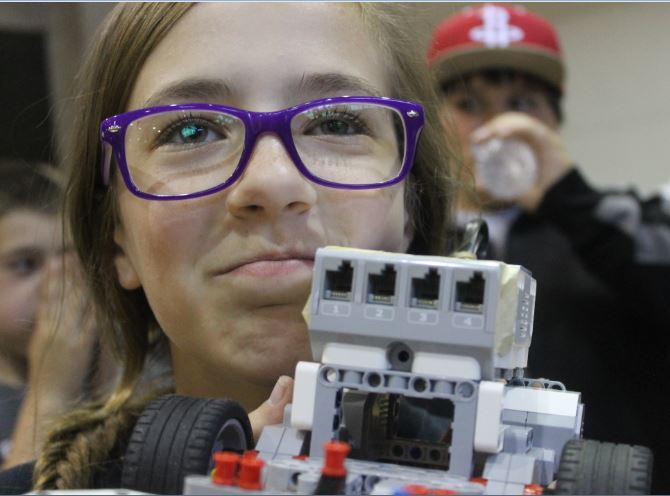 Saturday, April 11, seventh-grader Kaylie Ritter holds up her robot at the GEAR competition. Ritter and her partner, eighth-grader Madison Friemel, got 57th place.