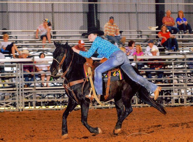 This photo ran with GroomTigerTimes.com's first feature story of Mallie Williams two years ago. This year Williams experienced the Oklahoma earthquake, prior to her competition on Saturday, Sept. 3, in Cherokee, Okla. In 2015, sixth-grader Mallie Williams hops off her horse in the goat tying competition. Being a true country girl at heart, she has always lived with livestock being a major part of life.