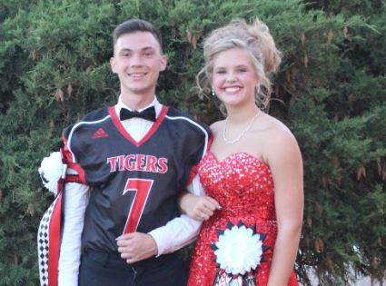 Eighteen-year-old Nick Kolesnikov and freshman Halle Barkley pose together before Homecoming coronation. Kolesnikov was voted on court after being in America for only a month. One of his first U.S. experiences included learning how a Texas homecoming worked, complete with GHS traditions in full effect.