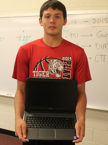 Staff Writer, Hayden Ritter is holding one of the new laptops that will be passed out next week, to fulfill the states wishes of one-to-one initiative.
