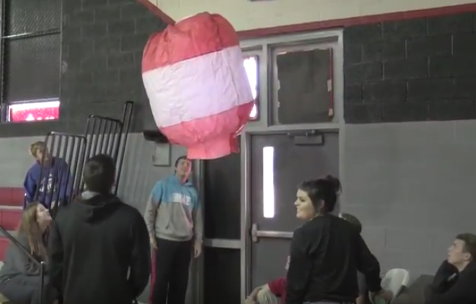 Members of Larry Roskens' second-period Chemistry class watch as one of their hot air balloons takes flight in the gym. Not all of the balloons lifted with as little adversity as this one. Watch this week's broadcast to see the results of all of their attempts to let their learning soar.