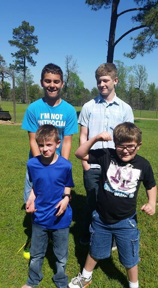 William Kelly, back left, stands next to his brother Cody Ragain for a family photo. Their brothers Jacob and Ryan Ragain join them. In this installment of