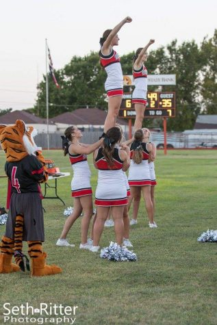 The GHS cheerleaders stunt during a chant with the help of the shouts coming from the pep squad and the fans in Higgins on Friday, Aug. 26.