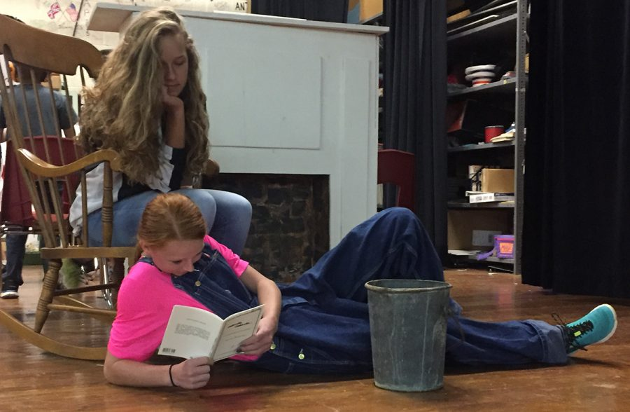 Junior Chelsey Lamb and freshman Ginna Miller read through their script with just a few of the props that will be used in the Theater class's fall production, which will be presented Thursday, Oct. 13. The group will be performing