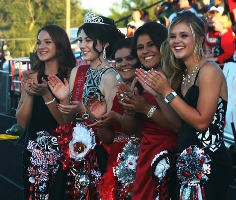 The homecoming court -Sydney Ritter, Caroline Britten, Leslie Germany, Jamey Germany and Halle Barkley - cheers on the Tigers at the game Friday night, Sept. 9. The Tigers came out defeating the Fort Elliott Cougars with a final score of 90-44.