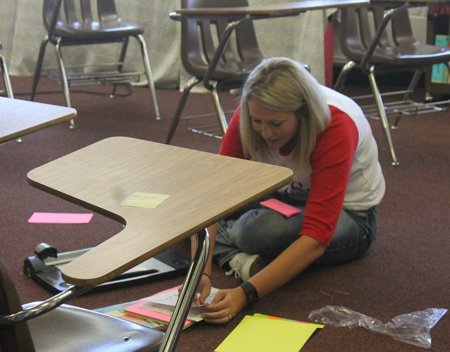 Assistant cross country coach Nicole Black prepares numbers for the Groom cross country meet that will take place at the Cross on the west of town Saturday morning, Oct. 1, starting at 9.  There will be a total of six teams running.