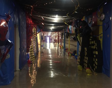 Homecoming arrived early this year, but that didn't stop the high school cheerleaders from filling the hallway with superhero decorations.