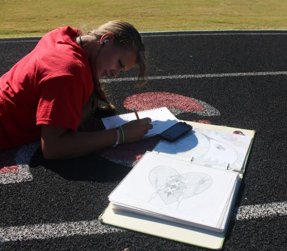 Chandra Rice draws while sitting on the track and listening to music  outside. According to her column, light matters to this photographer.