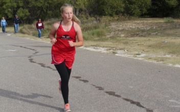 "Freshman Laurel Fields runs her race at the Spearman Cross Country Meet Oct. 8. While none of the Groom cross country teams won, junior high runners, Braxton Johnson and Braedon Williams, brought home two medals. ""It was the hardest course we've done all year,"" Laurel Fields said."