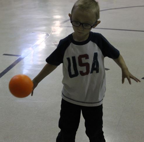 Four-year-old Mason Bell focuses on the ball as it comes his way. Bell will receive his needed surgery either this month or next month.