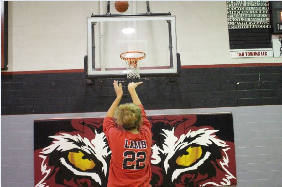 Junior Chelsey Lamb practices her shooting form in preparation for the basketball clinic that is to be held in the big gym on Nov. 5. The 'Ettes' will be running the fundamentals clinic for grades kindergarten through sixth.