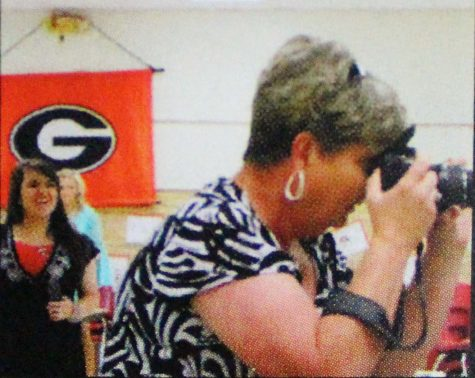 The Groom News owner and publisher Donna Burton sets her aim straight on Groom students, following an annual athletic banquet, one of  many school events that she's attended over the past several years. In spite of Stage 4 metastatic lung cancer that has progressed through much of her body, Burton, wakes each day and chooses her community first.