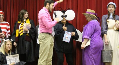 Principal Stephen Vanderpool goes along the line of teachers and listens for applause votes from students. The teachers all dressed as their favorite literary characters on Nov. 22. Here the
