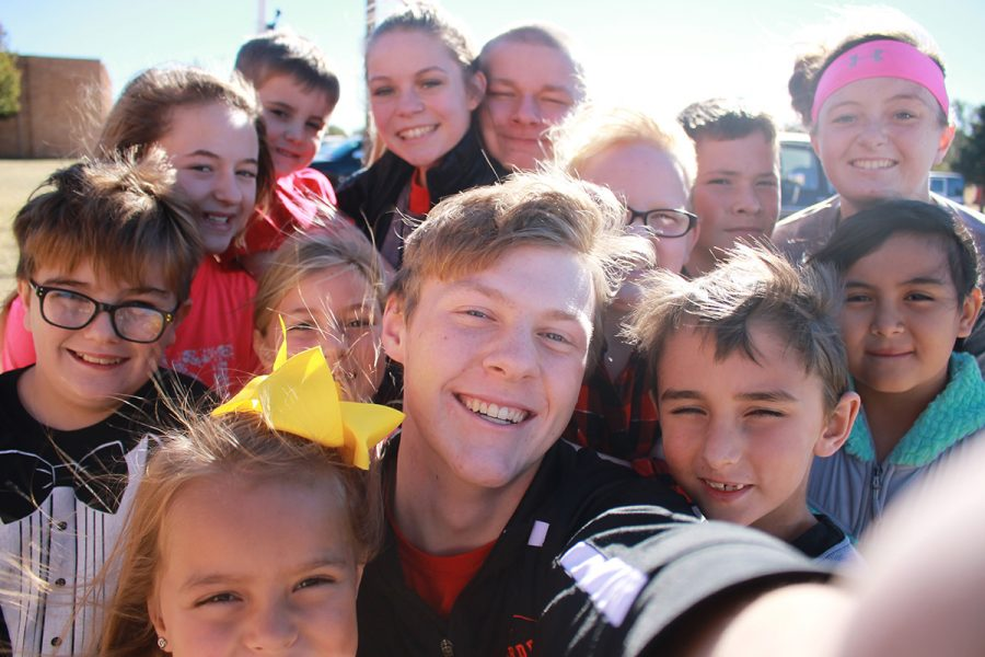 Students 'selfie' to celebrate game-day and Thanksgiving Break dismissal. Then, behind the scenes, photographer Halle Barkley grabs a shot of their work with her camera, too. School lets out today at 3:47 and will resume Monday, Nov. 28.