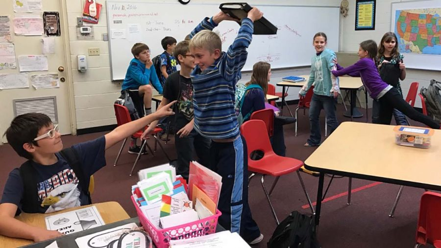 Xander Carabajal freezes with an aim on competitor and classmate Liam Lambert. The new trend that has been roaming all over social media is the Mannequin Challenge. The sixth-graders participated in their own version of the game in their history class. Its very hard not to move, sixth-grader Zadyn Johnson said. Since Im so active in class.