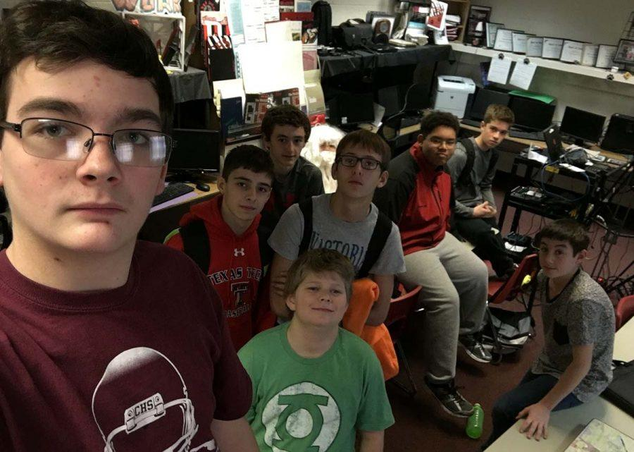 Santa+hides+somewhere+in+the+midst+of+these+eighth-grade+guys%2C+who+have+been+working+on+a+broadcast+project+in+their+journalism+class.+Zander+Mays%2C+front+left%2C+holds+the+camera+for+this+%22group+selfie%22+shot%2C+taken+after+the+guys+had+finished+shooting+their+interviews+and+%22B-roll.%22+You+can+find+all+of+these+eighth-graders+surrounding+their+guest+star%2C+including+one+who+is+playing+that+star+%28aka+Santa%29%3A+Braedon+Williams%2C+Braxton+Johnson%2C+Santa+Claus+%28aka+Samuel+Ybarra%29%2C+Tanis+Terbush%2C+Tre%27+Byers%2C+Gunner+Lamb%2C+Shawn+Meaker+and+Chance+Wheeler.+Their+finished+work+should+publish+on+GroomTigerTimes.com+in+the+GTTV+section+over+the+holidays.