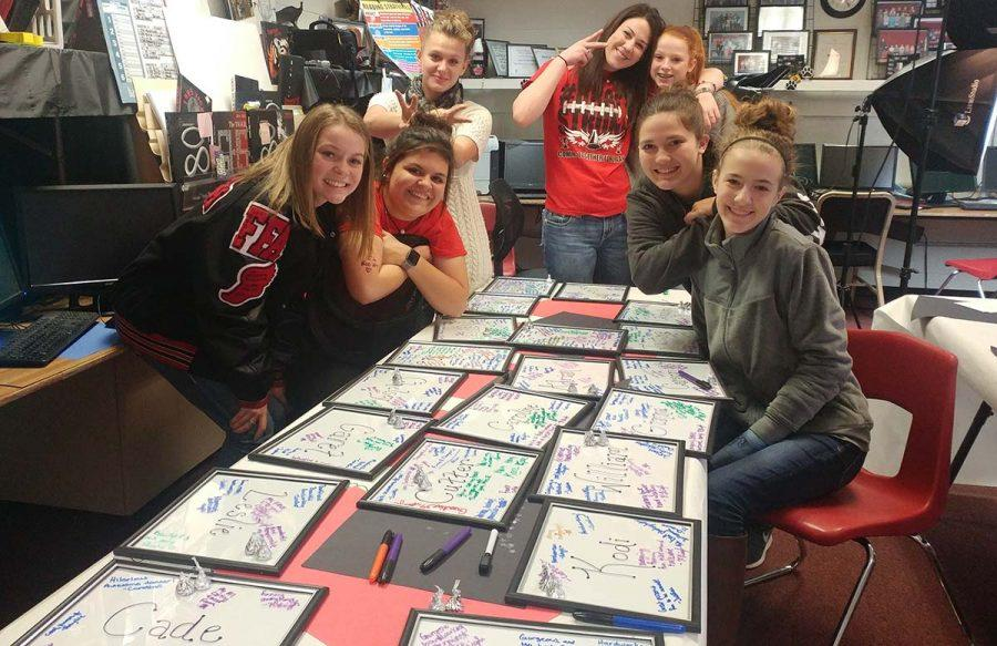 Morning journalism class signs each frame with adjectives that describe their fellow co-workers. School will dismiss at 3:47 this afternoon Dec. 20, and classes will resume on Wednesday, Jan. 4 at 8 a.m. Merry Christmas and Happy New Year, from GroomTigerTimes.com.