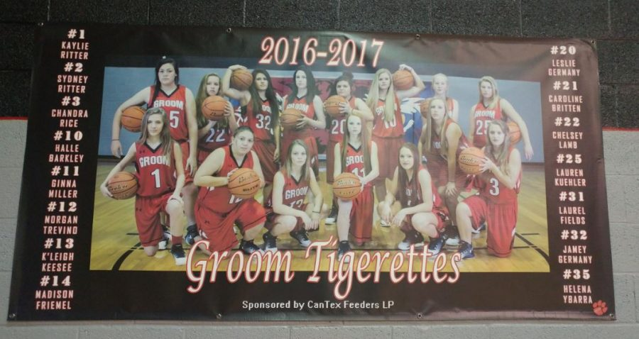 The Tigerettes stand ready to face opponents in the home gym. New team photos are featured in signs on the west end of they gym. Both the Tigers and the Tigerettes begin Friday morning, Dec. 16, still on the winners side of the bracket in the Groom Invitational Tournament, which continues through Saturday.