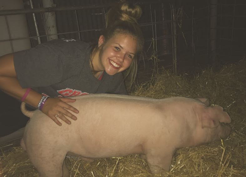 Sophomore Halle Barkley meets Fancy for the first time. Barkley will take this pig to the Carson County Junior Livestock Show and the Fort Worth Stock Show and Rodeo. I was super excited that stock show season was here, Barkley said of that night.