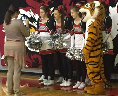 Varsity cheerleaders take instructions from cheer sponsor Melissa Ritter. The cheerleaders prepared a video for the people of Iraan, who faced a tragedy on Friday, Dec. 2 when their cheer bus collided with a 18-wheeler.