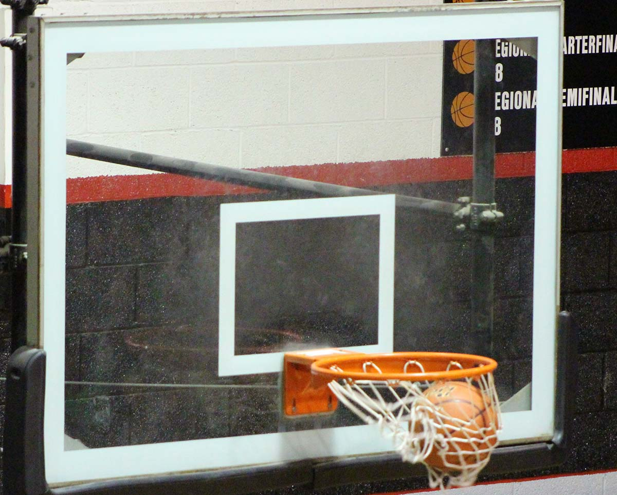 Freshman photographer Chandra Rice catches a photo of a made basket by the Tigers during their game on Tuesday, Jan. 10 against Shamrock. The Tigerettes will play Hedley tonight, Jan. 13 at 5, followed by the Tigers at 6:30.