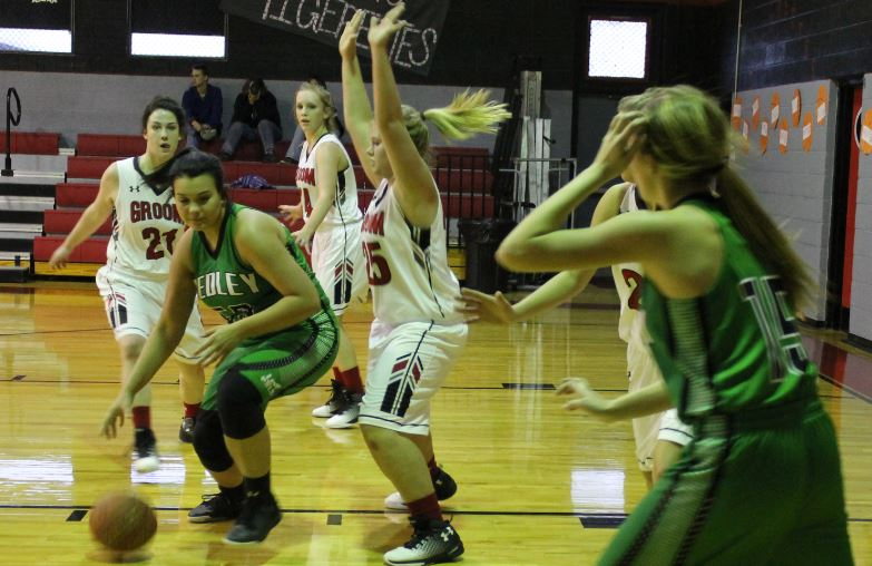 Junior Lauren Kuehler plays hands-up defense against the Hedley Owls on Friday, Jan. 13. Both Groom teams put up the winning points on the home-town scoreboard for these district matches. The varsity girls won 45-20. The boys won 60-30.