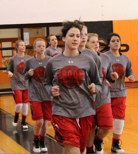 The 'Ettes warm up by running laps around the Lefors gym. The varsity girls traveled to play their district opener, winning 52-14.