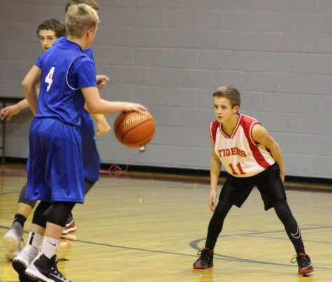 Seventh-grader Cael Ruthardt plays defense against White Deer in a home game earlier this season. The junior high girls  will play in Groom this afternoon at 5 against Shamrock at home, followed by the boys. The 'Ettes' first district game will be Friday, Jan. 6 at 6 p.m. in Lefors.