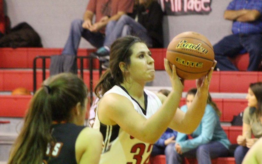 Junior Jamey Germany lines up her shot on the free throw line. The 'Ettes and Tigers won their game Tuesday night.