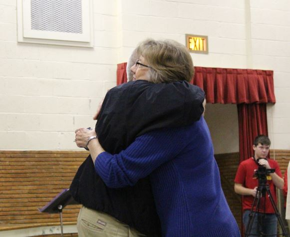 Mrs. Frances Payton hugs Superintendent Jay Lamb after receiving her ring at the ring ceremony. Jostens paid for Payton's ring, honoring her 36 years at Groom school.