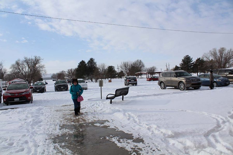 Fourth-grader Abby Bowen makes her way into the school after a two-hour snow delay. The varsity girls basketball game has been rescheduled for Saturday afternoon, Jan. 7 at 2 in Lefors. Its fun to see snow again, senior Jeff Marshall said. Since we havent seen it in over a year.