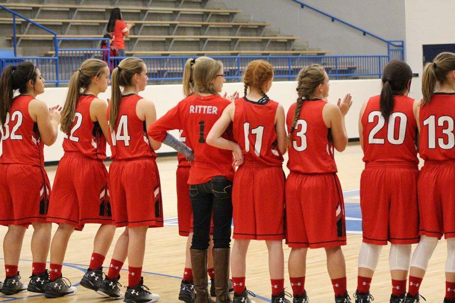 The Tigerettes line up for pre-game ceremonies during their match-up  on Tuesday, Jan. 17 in White Deer.  The Ettes will play the Lefors Lady Pirates tonight, Jan. 24, at 6 in Groom, followed by the Tigers. Im excited to start the second half of district, freshman Ginna Miller said.