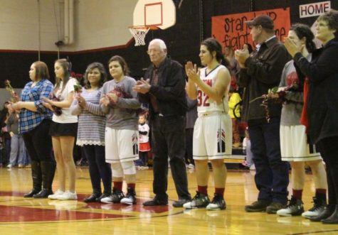In front of a packed gym of spectators for the final home games of 2017, seniors received their traditional roses marking their final season of basketball and cheerleading. Parents met their future graduates in a center-court ceremony on Feb. 3. Coach Nicole Black  served as the between-games announcer.