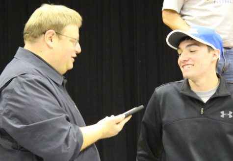 Smiling & Signing<br>Photo of the Day – Feb. 16