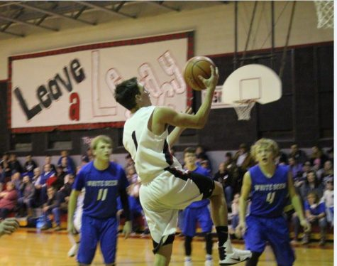 Senior Carson Ritter goes up for a layup. The Tigers won their game against the White Deer Bucks.