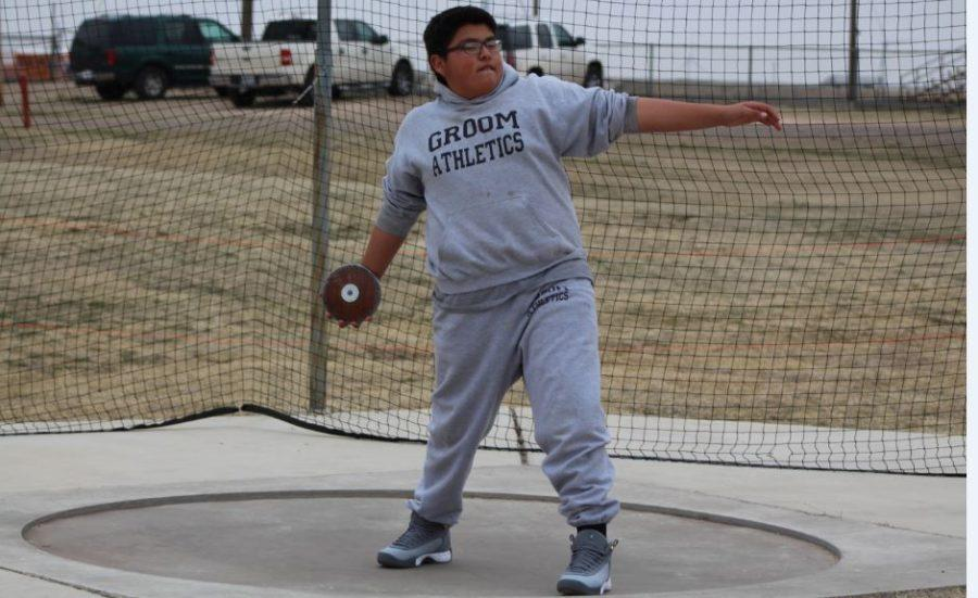 Eighth-grader Matthew Hernandez practices his discus warm up before today's Groom Relays Track Meet. See the attached schedule for a list of all of the events that will be held for the 13 schools competing during this two-day event.