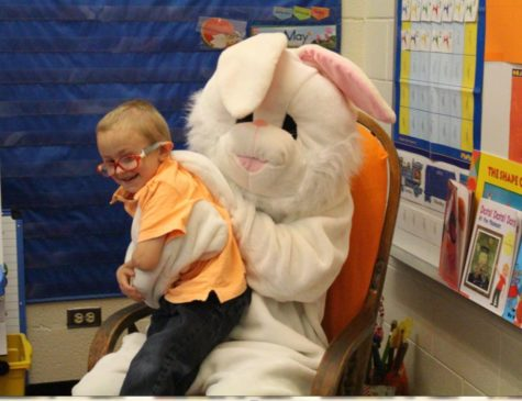 Preschooler Mason Bell enjoys a surprise visit from the Easter bunny on Thursday, April 13. Bell was diagnosed with craniosynostosis and had to undergo surgery on his skull.