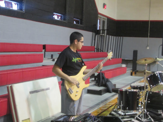Senior Garet Rocha plays the bass guitar to test sound for one of last year's STAAR pep rallies.  Rocha has attended Groom School since kindergarten.